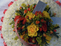 Large Posy Pad Funeral Tribute - Edged in Ribbon, based in White Chrysanthemums with a spray of flowers in Yellow, Orange and Red